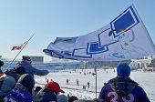 Irkutsk,Ru-Feb,26 2012:Team fans with flag on spectator grandstands in Feb,26 2012 in Irkutsk, RU