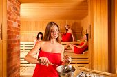 Sauna wellness - young happy women, presumably friends, in Spa