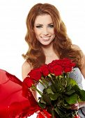 attractive woman in red drapery with red roses
