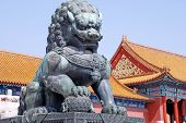stock photo of emperor  - Ancient bronze lion and red chinese pavilliones in Emperor Forbidden city - JPG