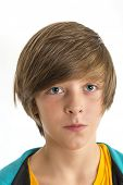 Teen Boy Smirking Into The Camera, Isolated On White