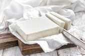 foto of curd  - Fresh cheese Feta on a chopping board - JPG