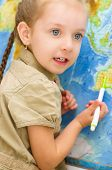 Child In Front Of World Map
