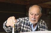 Close Up Of Aged Senior Man Painting