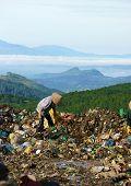 People pick up trash at garbage ground