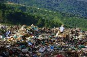 People pick up garbage at landfill