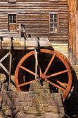 Rustic Wheel On Water Mill