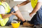 stock photo of bandage  - Construction worker has an accident while working on new house - JPG
