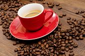 Arabica Coffee Beans And Red Espresso Mug