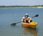 Senior And Dog Kayaking