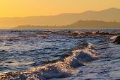 stock photo of sea-scape  - Beautiful landscape of distant sunset mountain ridges at Aegean Sea near Gumuldur Turkey - JPG