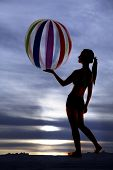 Silhouette Hold Beach Ball In Palm Of Hand