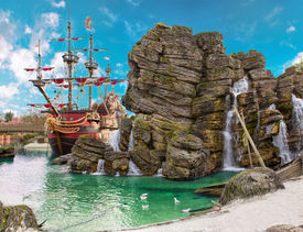 image of pirates  - Pirate ship in the backwater of tropical pirate island with big rock in form of skull near it - JPG
