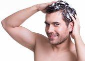 Young Happy Smiling Man Washing Hair.