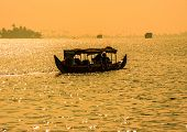 picture of alleppey  - Sunset silhouette scene of a boat from the backwaters of Kerala India - JPG