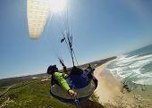 Paraglider pilot in flight