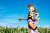 Female Farmer Working In Corn Field
