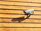 Surveillance Cameras On Wooden Wall