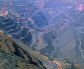 stock photo of iron ore  - Production of iron ore in quarry by open way the overall look. ** Note: Soft Focus at 100%, best at smaller sizes - JPG