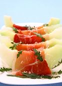 Ripe Melon With Ham, Parmesan Cheese On White Plate