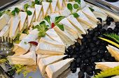 Decorative Tray With Cheese And Black Olives