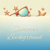 Sandy beach with starfish and sunglasses. Summer background
