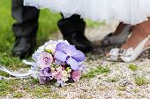 Wedding Bouquet And Bride And Groom