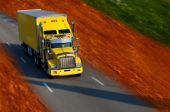 stock photo of semi-truck  - A yellow semi truck on the road - JPG