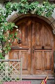 Wooden door in Eguisheim village along the famous wine route in Alsace France