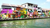Street art on buildings along the Melaka river.
