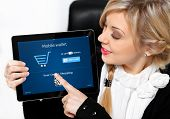 Businesswoman Holding A Tablet With Onlain Shopping On The Screen