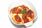 A Casserole Dish With Baked Stuffed Pasta Shells