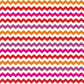 Chevron seamless colorful vector pattern or background with red, purple, pink zig zag