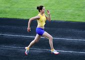 Girl Running on Stadium Track