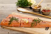 stock photo of fish skin  - Salmon with honey marinade ready to cook - JPG