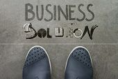 Handdrawn Business Solution Design Word On Front Of Business Man Feet As Concept