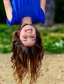 Beautiful Child Hanging Upside And Laughing
