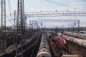 Long Freight Trains At Railway Station With Many Railroads And Wires At Summer. Above View