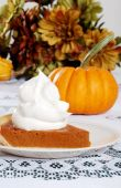 picture of pumpkin pie  - closeup of a Slice Pumpkin Pie With Lots Of Whip Cream - JPG