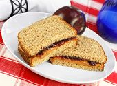 Healthy Lunch Of Peanut Butter And Jelly Sandwich On Whole Wheat