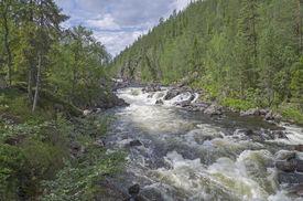 stock photo of murmansk  - Rapids on the small mountain river in the Murmansk region Russia - JPG