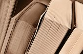 closeup of some books, in sepia tone