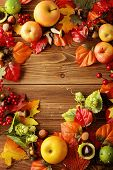 autumn - colorful leaves, apples and mushrooms on wooden background