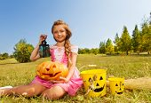 Girl in costume of princess sitting with  pumpkin