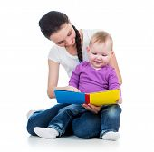 Happy Mother Reading A Book To Kid Girl