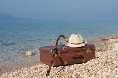 Vintage Leather Suitcase On The Beach