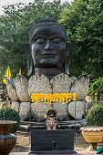 buddha head in lotus flower at Wat Thammikarat temple at Ayutthaya Bangkok Thailand