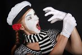 stock photo of clown rose  - Portrait of a mime comedianon black background - JPG