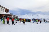 Skiers Enjoy Skiing At The Slope In The Austrian Alps