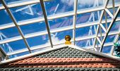 Tile Roof With Glass Atrium Roof In Background